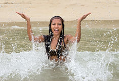 Indian woman playful in the sea Royalty Free Stock Photo