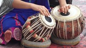 Indian woman playing Indian music on Tabla Punjabi drums stock video footage