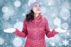 Indian woman playing snow with bokeh background Royalty Free Stock Photography