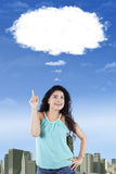 Indian woman pointing at cloud Stock Photos