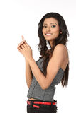 Indian woman pointing her finger at copy space Stock Photography