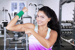 Indian woman pointing her muscle Stock Images