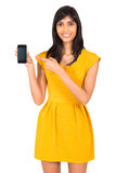 Indian woman pointing phone. Happy indian woman pointing at smart phone isolated on white Royalty Free Stock Photo