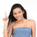 Indian woman pointing up at copy space Royalty Free Stock Images