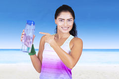 Indian woman pointing at water bottle Stock Photos