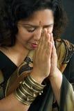 Indian woman praying stock image
