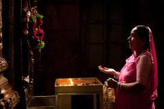 Indian woman prays inside Meenakshi Temple. India Stock Image