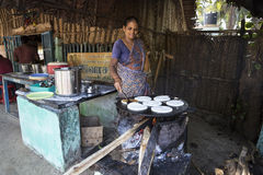 Indian woman preparing dosa at a kitchen, Auroville Stock Image