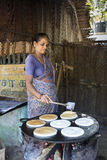 Indian woman preparing dosa at a kitchen, Auroville Royalty Free Stock Image