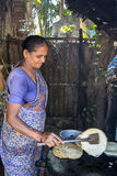 Indian woman preparing dosa at a kitchen, Auroville Royalty Free Stock Photography