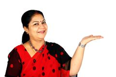 Indian woman presenting. Stock Photo