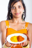 Indian woman presenting spices Stock Photos
