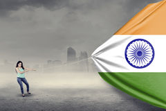 Indian woman pulling an indian flag Royalty Free Stock Photos