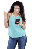 Indian woman reading message on smartphone Royalty Free Stock Photography
