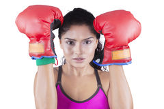 Indian woman with red boxing gloves Stock Photos