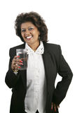 Indian Woman - Refreshment. An attractive Indian businesswoman drinking a glass of water. Isolated on white royalty free stock image