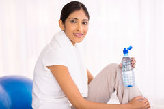 Indian woman resting. Pretty indian woman resting at gym Royalty Free Stock Photos