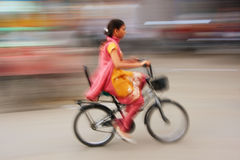 Indian woman riding bike, blurred motion, Sadar Market, Jodhpur Stock Images