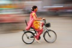 Indian woman riding bike, blurred motion, Sadar Market, Jodhpur Stock Images