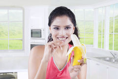 Indian woman with ripe banana Royalty Free Stock Photography