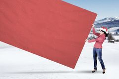 Indian woman with Santa hat and blank billboard Stock Photography