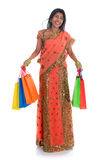 Indian woman in sari dress shopping Royalty Free Stock Photo