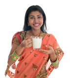 Indian woman in sari drinking milk Stock Photography