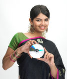 Indian woman in sari holding CD Royalty Free Stock Photo
