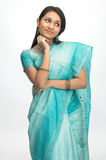 Indian woman in sari with thinking expression Royalty Free Stock Photography