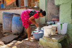 Indian woman washing clothes on the street Royalty Free Stock Images