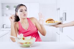 Indian woman refusing junk food Royalty Free Stock Photo