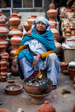 Indian woman selling clay pots Royalty Free Stock Photography
