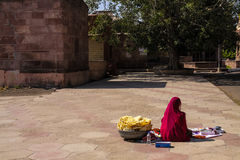 Indian Woman selling kitkats small eats at mandore monuments Royalty Free Stock Images