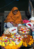 Indian woman selling pooja items in Varanasi, India Royalty Free Stock Image