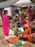 Indian woman selling potatoes. ORISSA, INDIA - Nov 12 - Indian woman selling potatoes and other vegetables at a weekly market on Nov 12, 2009 in Ankadeli, Orissa royalty free stock image