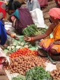 Indian woman selling potatoes. ORISSA, INDIA - Nov 12 - Indian woman selling potatoes and other vegetables at a weekly market on Nov 12, 2009 in Ankadeli, Orissa stock photo