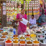 Indian woman selling spices at market Stock Photos