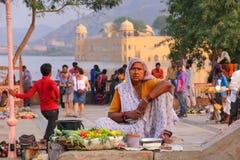Indian woman selling vegetables at Man Sagar Lake in Jaipur, Ind royalty free stock image