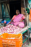 Indian woman selling vegetables at market. Chennai, India Royalty Free Stock Photography