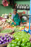 Indian woman selling vegetables at market. Chennai, India Stock Photo