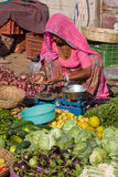 Indian woman sells vegetables in the market Royalty Free Stock Images