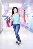 Indian woman with shopping bags in mall Royalty Free Stock Photos