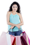 Indian woman with shopping bags on studio Royalty Free Stock Photo