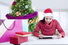 Indian woman shopping Christmas gifts online Royalty Free Stock Image