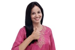 Indian woman showing thumbs up gesture Stock Images