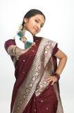 Indian woman in silk-sari holding CD Royalty Free Stock Photo
