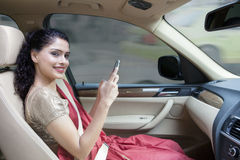 Indian woman sitting in the car Royalty Free Stock Images