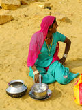 Indian woman sitting in a sand in a small village in Thar desert Royalty Free Stock Photos