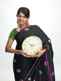 Indian woman standing with the clock stock image