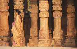 Indian woman standing by columns at Qutub Minar complex, Delhi Royalty Free Stock Image